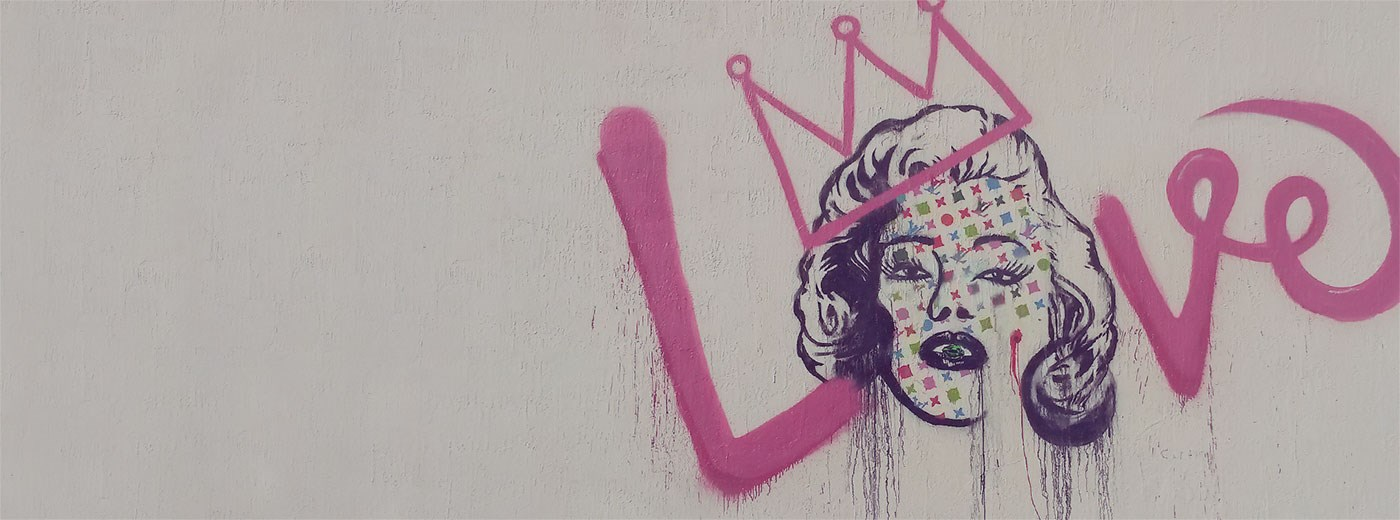 A piece of modern art incorporating a Marilyn Monroe graphic with graffiti style typography.